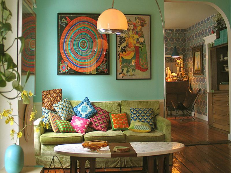 colorful touches for living room decor ideas represented with pictures on wall and pillows on sofa