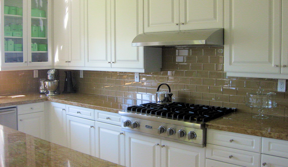 Grey Subway Tile Backsplash with Glossy Finishing to Match White and Stainless Steel Accents