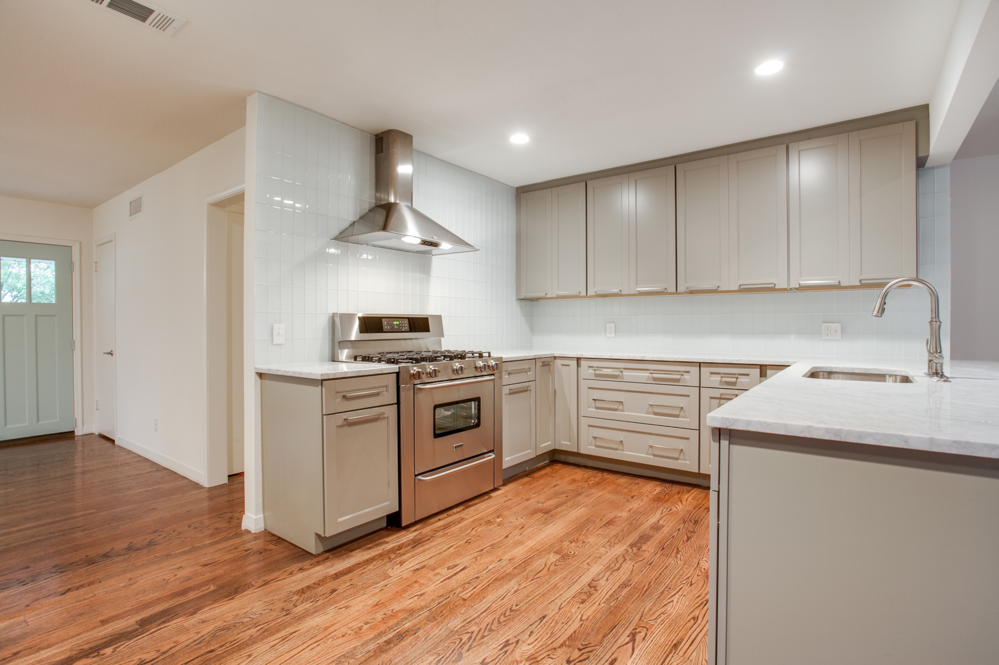 Impressive Plain White Kitchen Subway Tile to Meet Grey Furnishing and Wood Flooring
