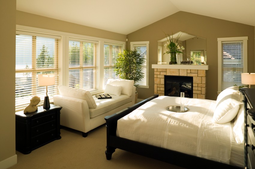 Inspiring Contemporary Feng Shui Bedroom with Triangular Ceiling and Fireplace