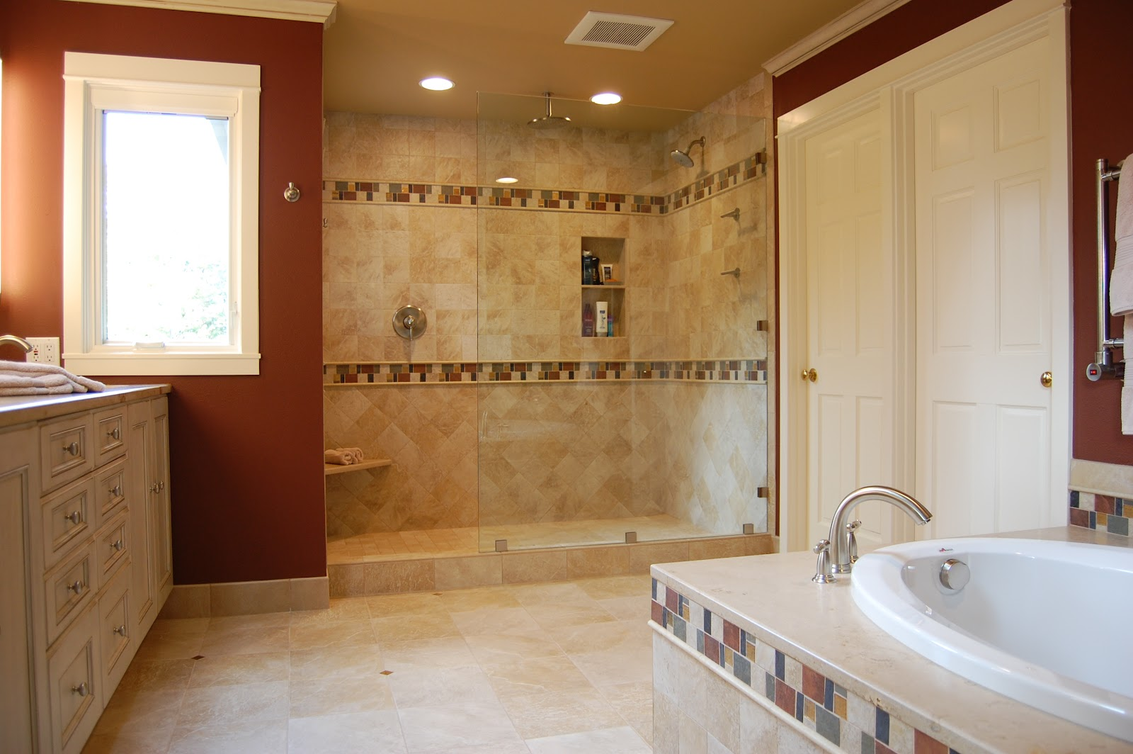 interesting bathroom remodel ideas with decorative trims on wall and tub and brown wall accents