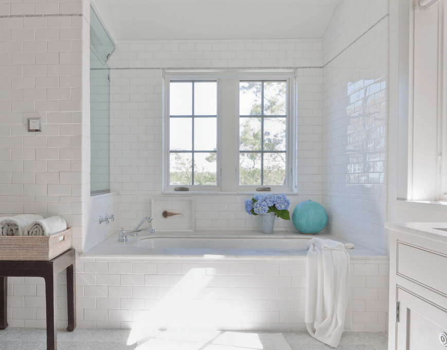 Pure White Bathroom with Subway Tile Ideas to Complete Bathroom with Built in Tub