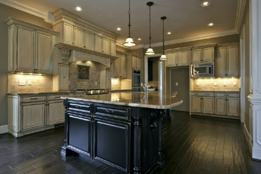 Beau Accent Black Island Combined With White Cabinets With Decorative Lighting