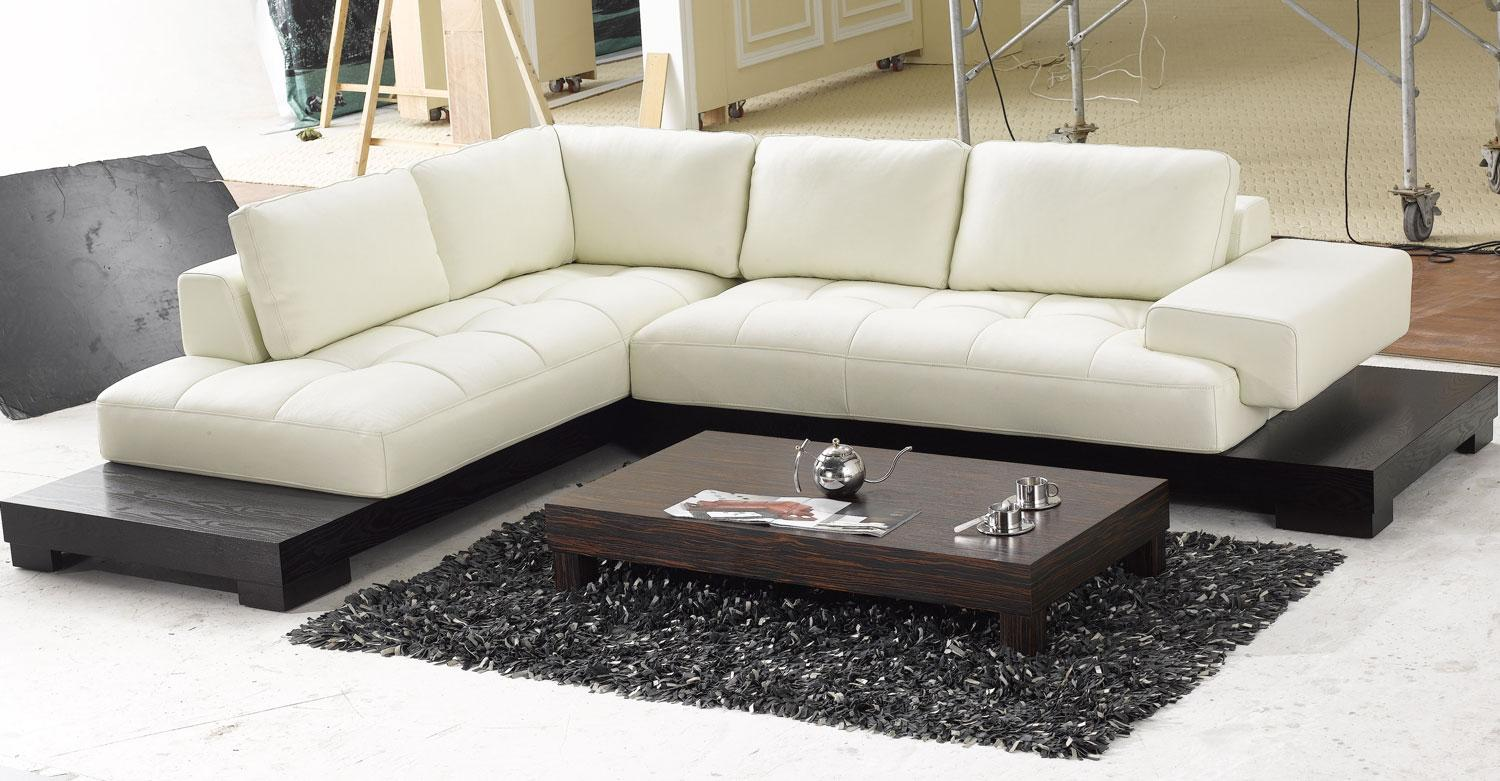 Add Dark Carpet Rug and Low Wooden Coffee Table near Modern Sectional Sofas