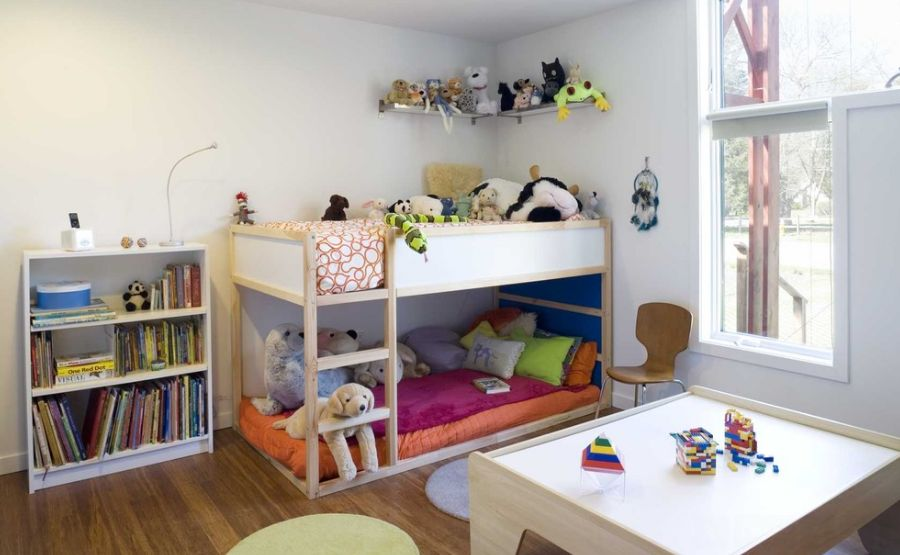Add Legless Toddler Bunk Beds and White Bookshelves inside Comfy Kids Bedroom with Laminate Flooring