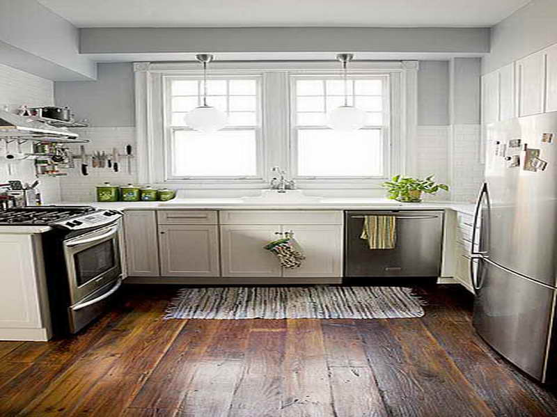 Appealing Hardwood Kitchen Flooring Idea Working with White Cabinet and Grey Wall Painting