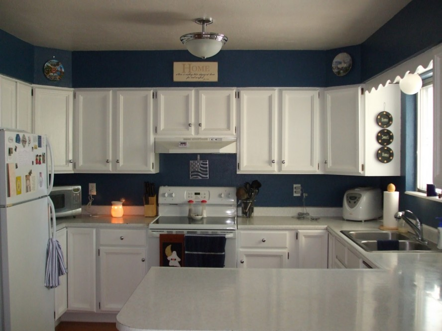 Appealing White Painting for Kitchen Cabinets with White Countertop and Blue Wall