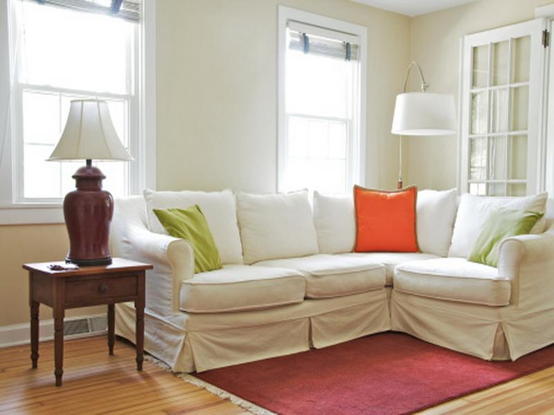 Arc Lamp and Small White Sectional Sofa near Wooden Side Table and Classic Table Lamp