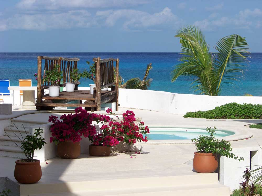 Beautiful Beach House with Excellent Outdoor Patio with Flowers on Vases