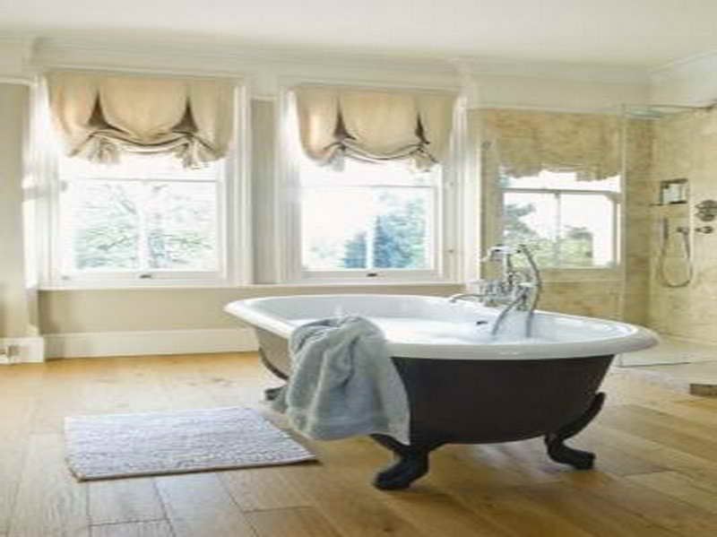 gorgeous bathroom with oak flooring and thick bathroom window curtains