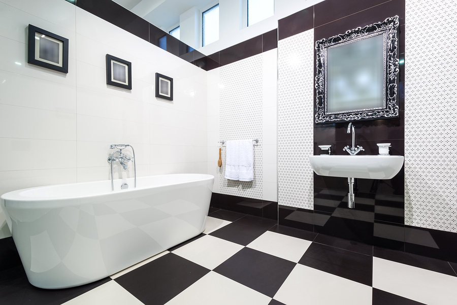Black and White Checkerboard Flooring Combined with Patterned Wall and Sleek White Tub