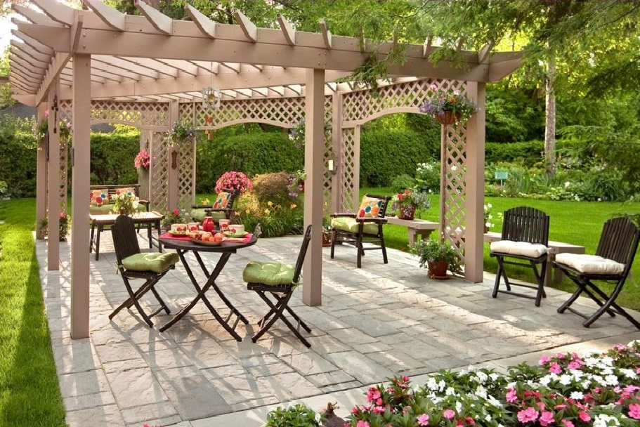 Breezy Backyard Patio with Unique Pergola and Moveable Seating Units Decorated with Flowers
