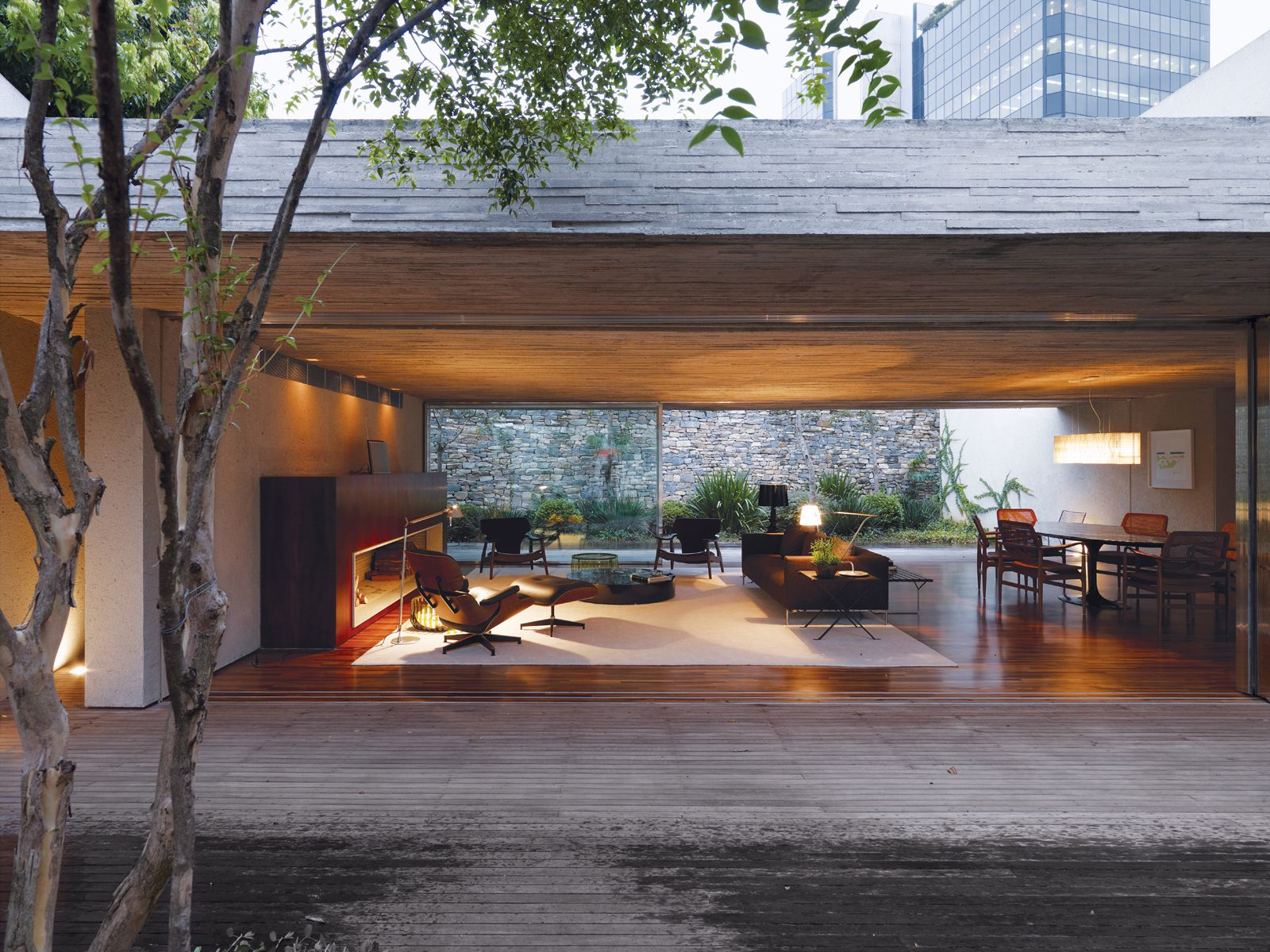 Breezy Outdoor Living Space with Open Wall Furnished with Minimalist Sofa and Cozy Lazy Chair
