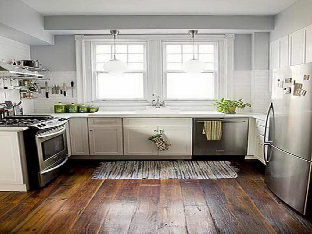 Bright White Kitchen Remodeling Ideas with Double WIndows and Wooden Flooring