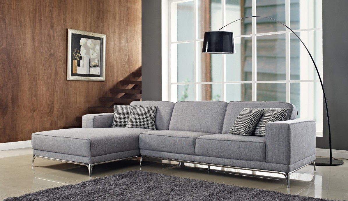 Brilliant Living Room with Modern Grey Sectional Sofas and Dark Arc Lamp facing Carpet Rug