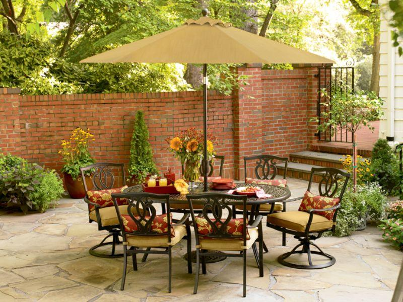 Brown Canopy Umbrella and Round Metal Table Surrounded by Outdoor Chairs using Stunning Fall Decorating Ideas
