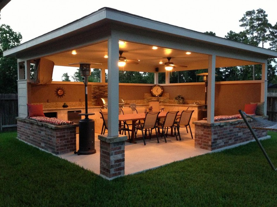 Built in Pergola with Exposed Brick and Wood Pillars Equipped with L Shaped Kitchen and Dining Space