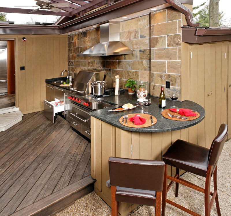 Captivating Natural Outdoor Kitchen Idea with Wood and Stone Touches and Stainless Steel Furniture