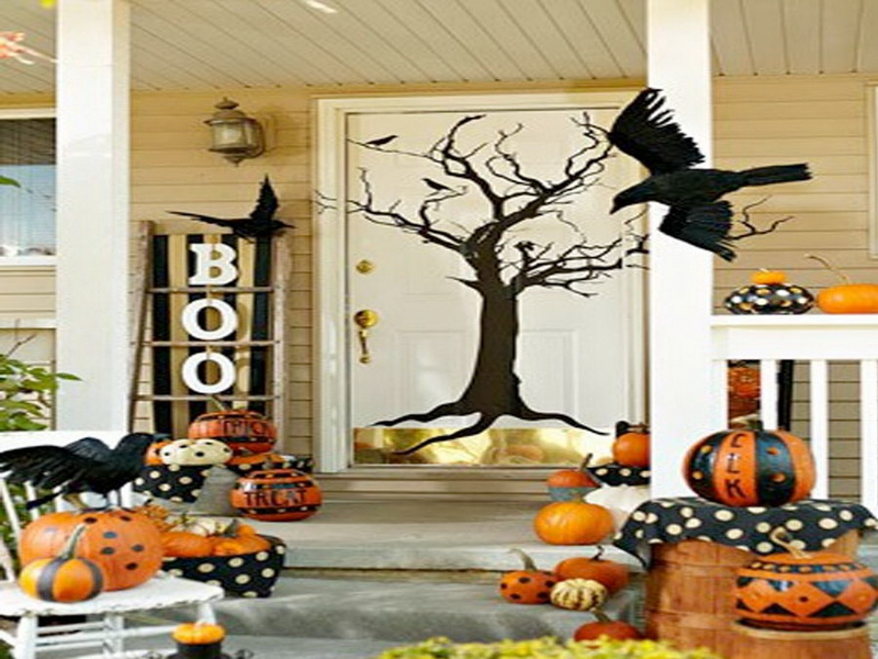 Celebrate Halloween using Brilliant Fall Decorating Ideas with Orange Pumpkins and Black Treen Door Mural