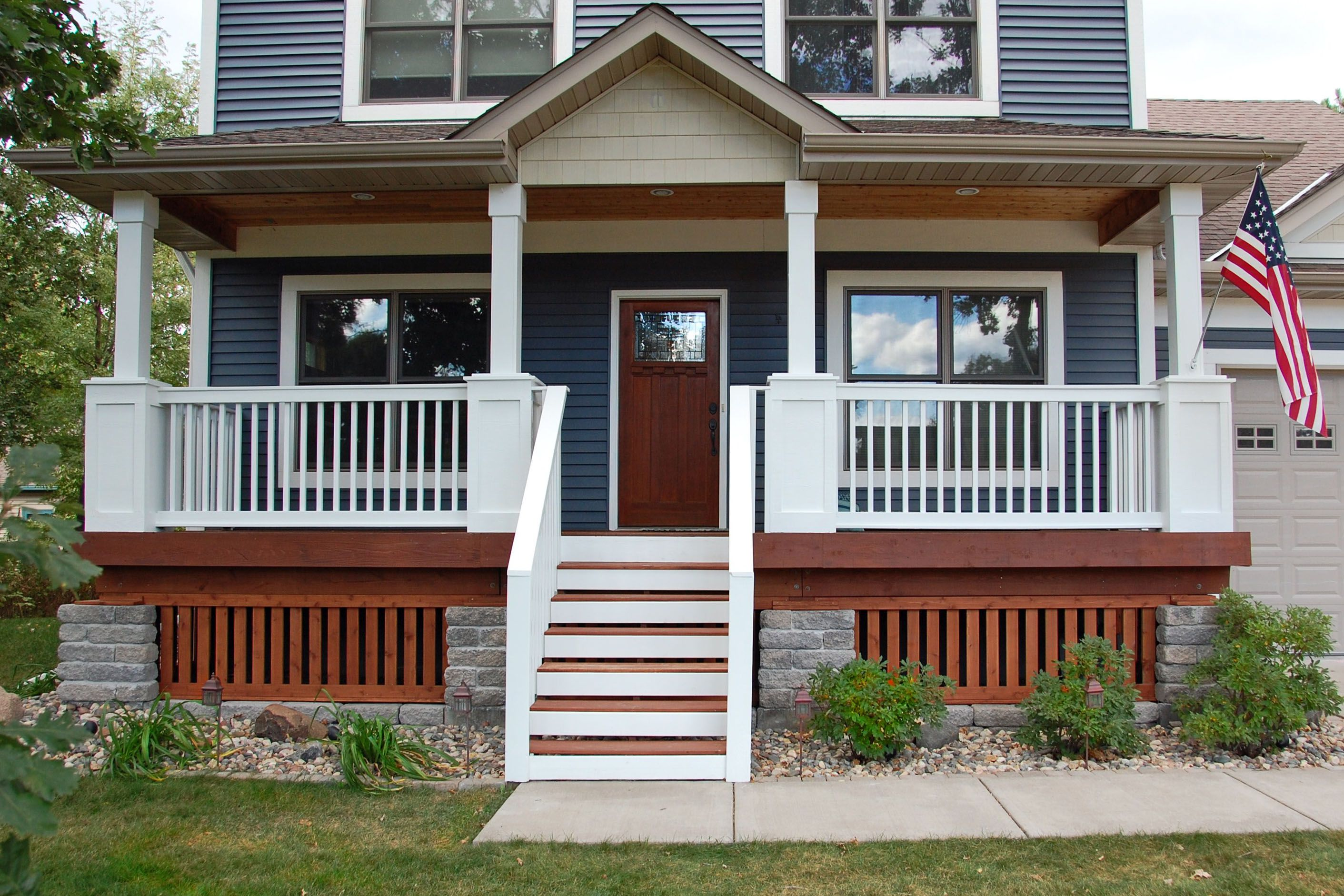 Choose Minimalist Front Porch Ideas for Small Space with White Fence and Wooden Stairs