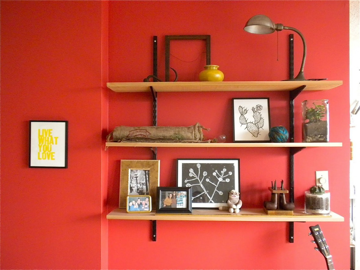 Choose Simple Wooden Shelves for Amazing Family Picture Ideas on Red Painted Wall inside Minimalist Room