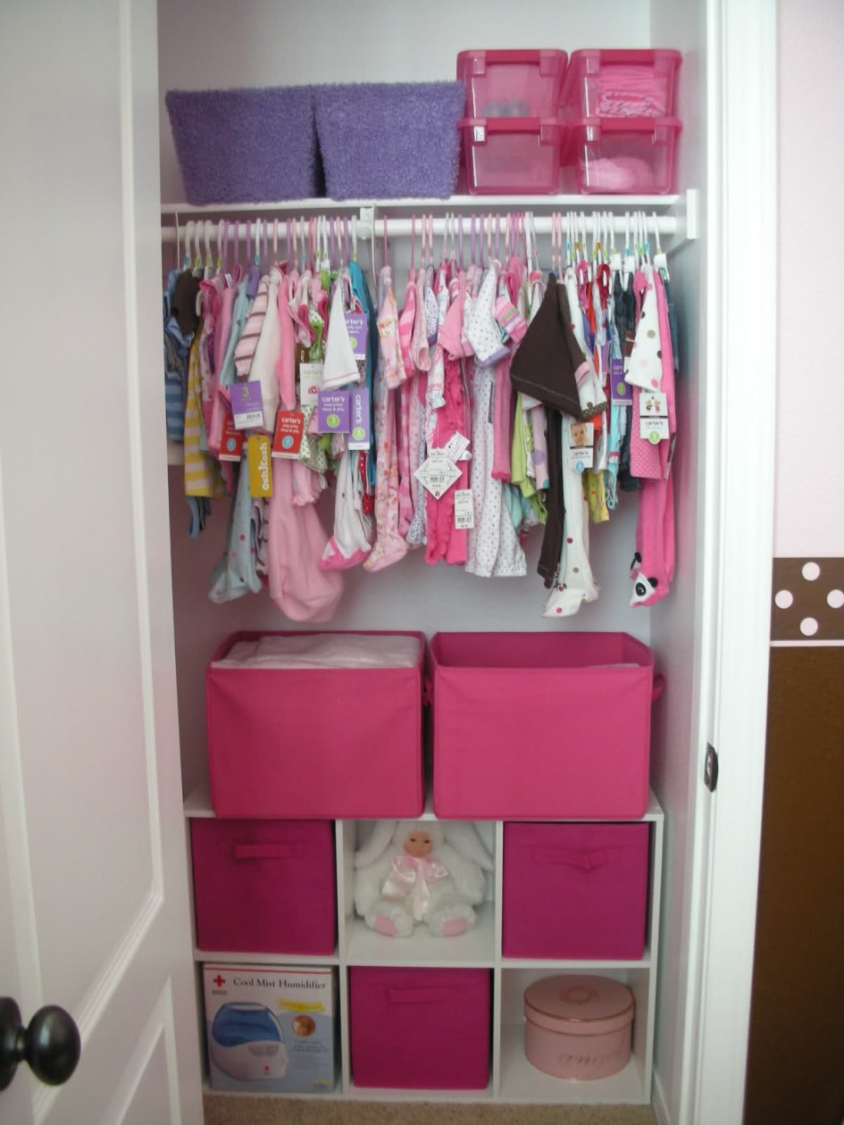 Closet Organization Ideas for Kids with Pink Boxes and White Shelves inside Small Closet using White Door