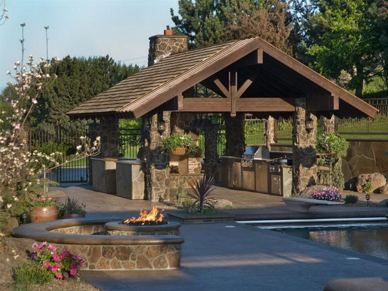 Comfy Outdoor Living Space Located Next to Swimming Pool Completed with Stainless Steel Kitchen