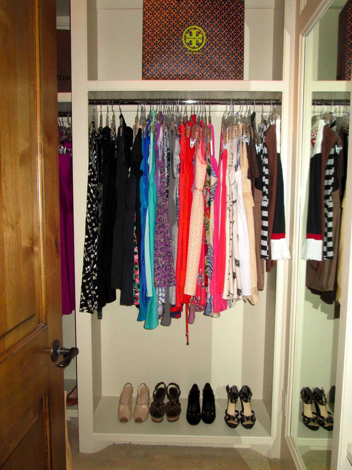 Complete Interesting Small Closet Organization Ideas with High Floor Mirror and White Shelves behind Wooden Door