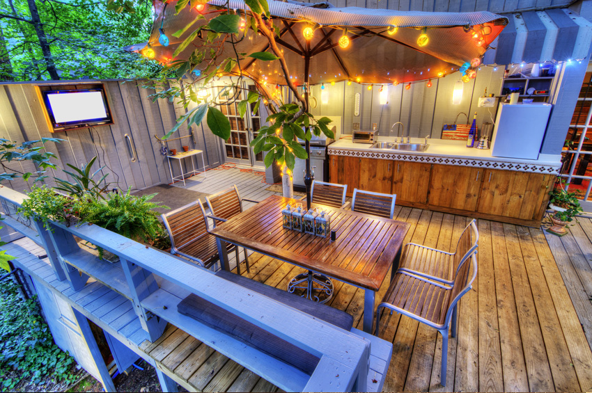 Complete Outdoor Living Spaces with Kitchen Featuring Gathering with Parasol