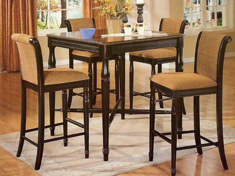 Complete Small Black Kitchen Table with Classic Stools and Grey Carpet on Oak Flooring