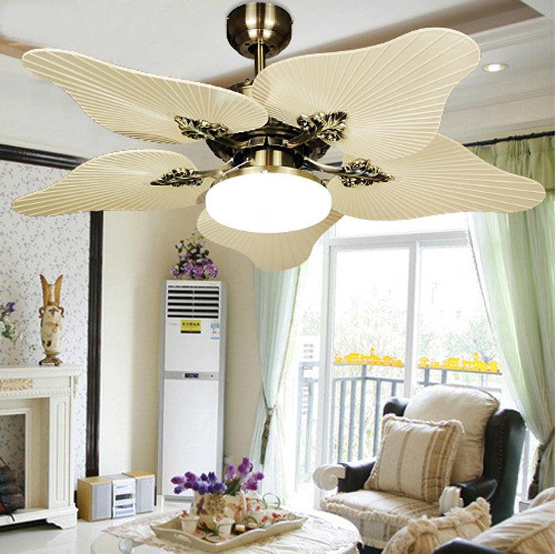 Complete the Classic Living Room with Unusual Modern Ceiling Fans and Classic White Fireplace