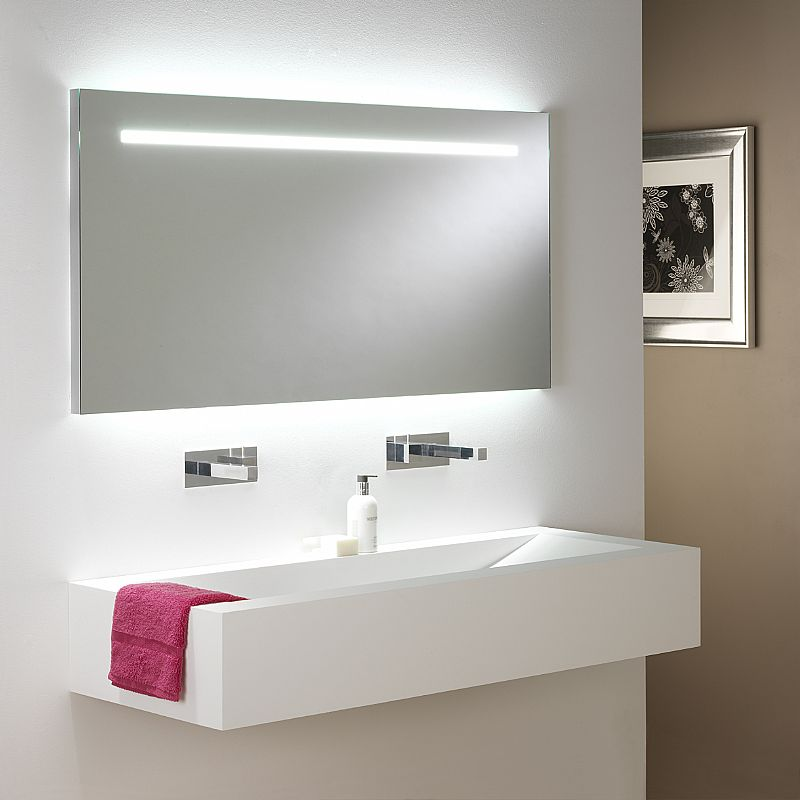 contemporary bathroom with floating sink and frameless mirror with decorative lighting
