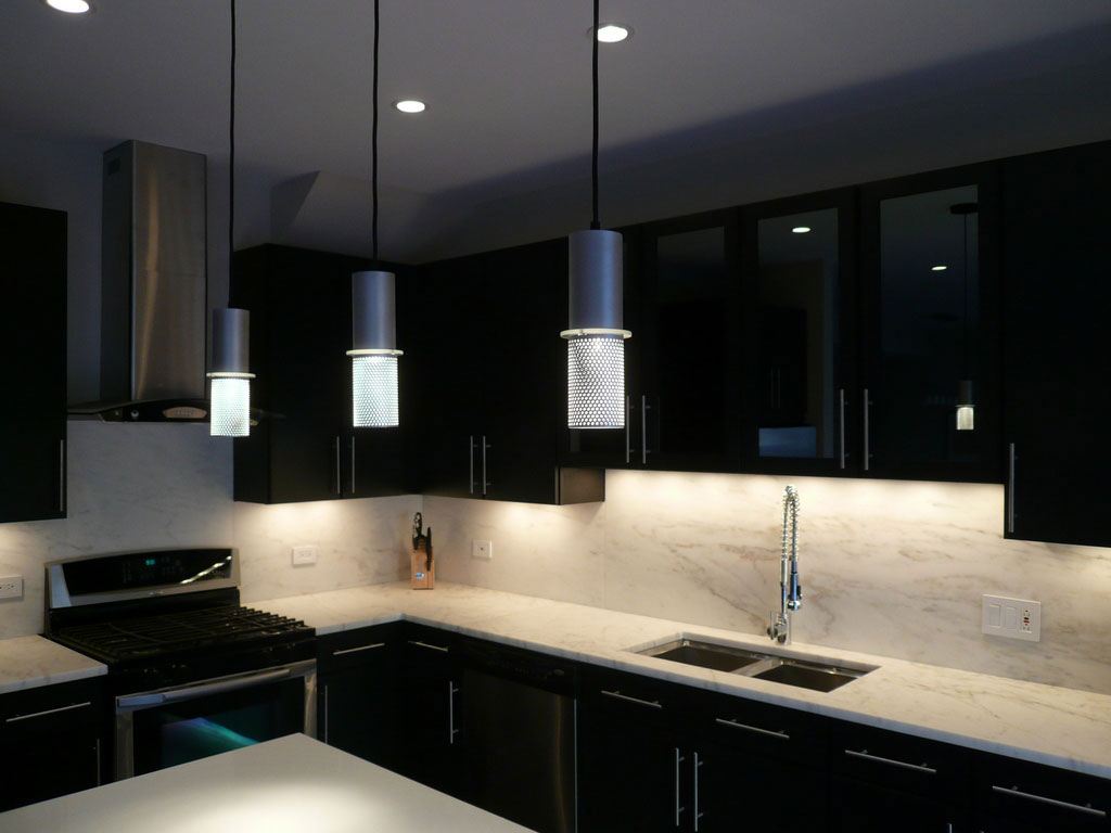 Contemporary Kitchen with Black Kitchen Cabinets Combined with Marble Top and Backsplash