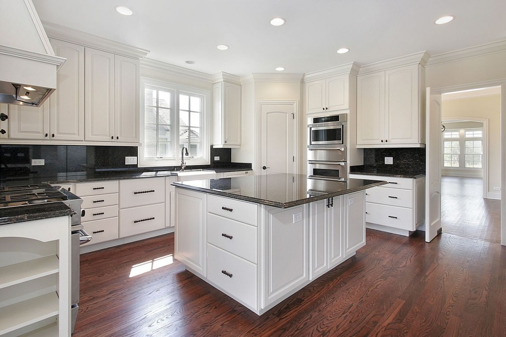 Cool Kitchen Interior with U Shaped Cabinets Refinished in White with Black Countertop
