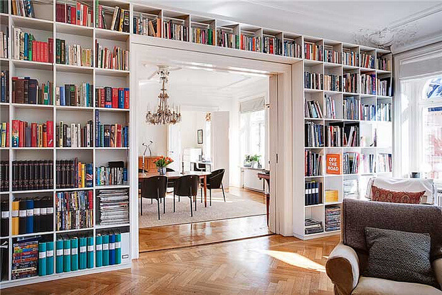 Covering the Wall with Floor to Ceiling Built in Bookshelves Showing That You Love Reading