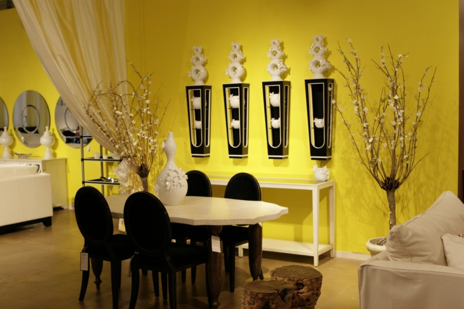 Cozy Dining Room with White Table and Black Chairs beside Stunning Wall Decor Ideas on Yellow Wall
