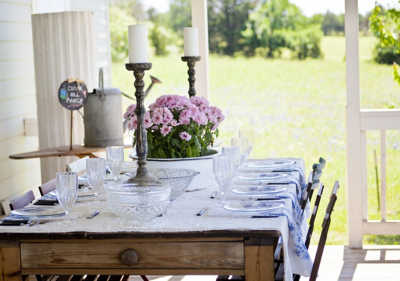DIY Wooden Dining Table Decorated with Flowers and Candles Representing French Country Style