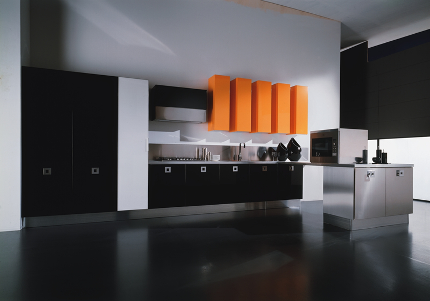 Dark yet Comfy Kitchen with Black Cabinets and Surpsising Orange Accents of Wall Storage
