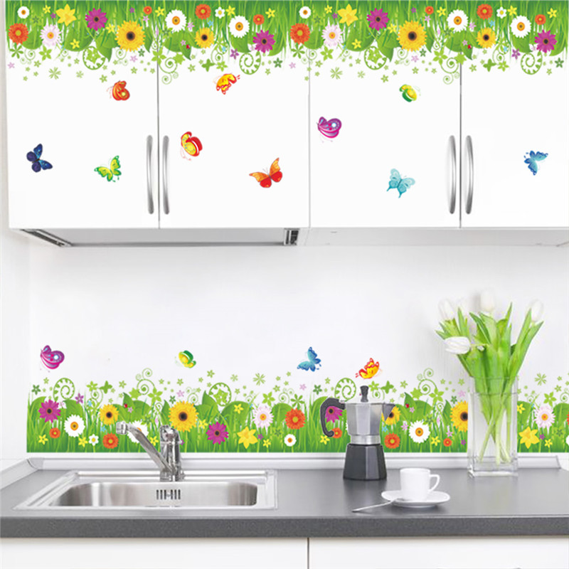 Decorate the Lovely Kitchen with Flowery Kitchen Wall Decor on White Cabinets and Clean Backsplash