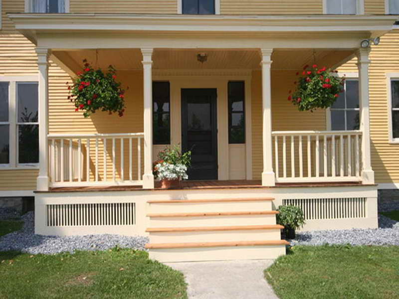 Decorate the Small Front Porch Ideas with Beautiful Flowers and Hanging Plants near White Fence