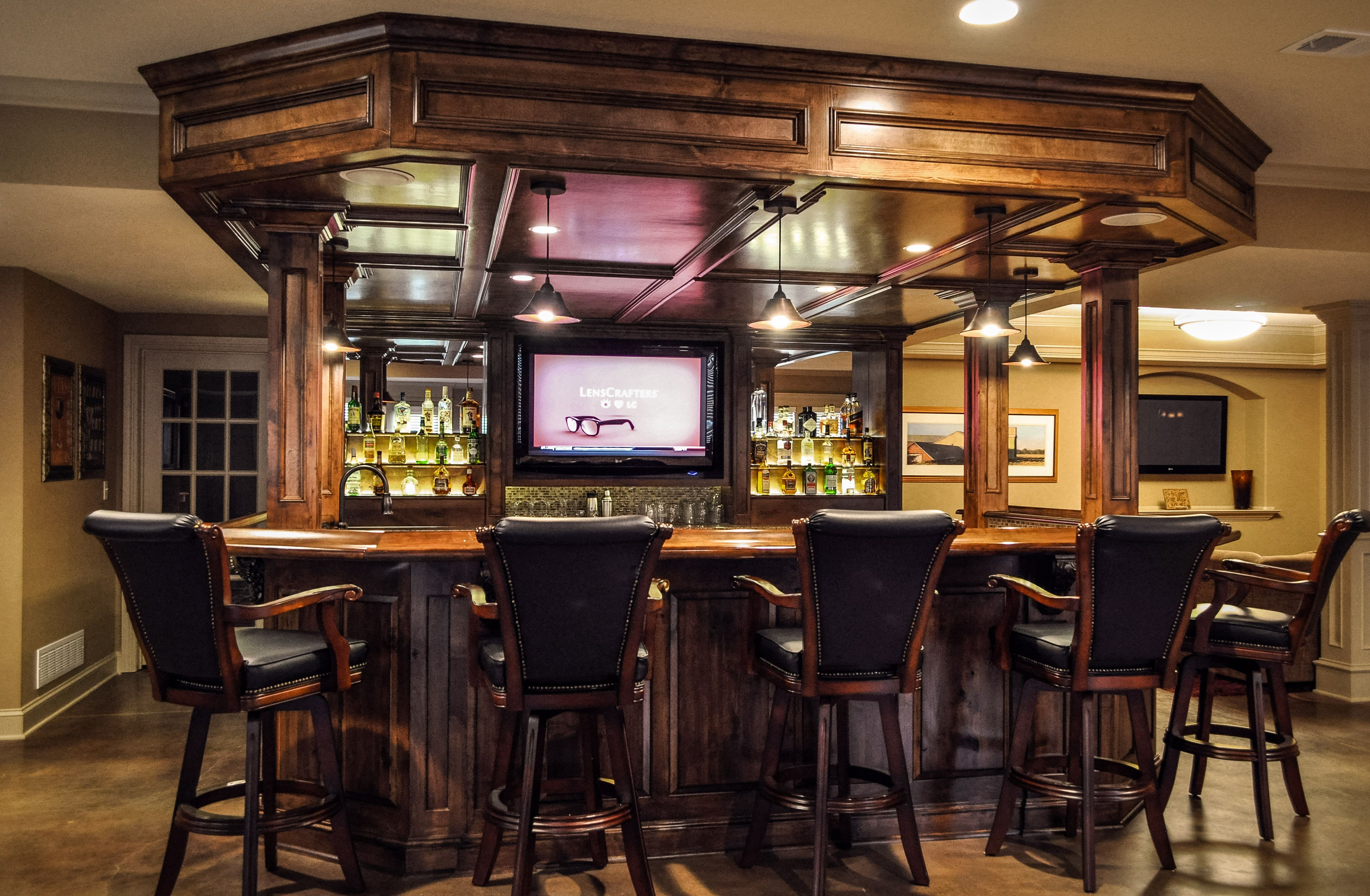 Elegant Basement Bar with Full of Wood Furniture and Soothing Lighting Features