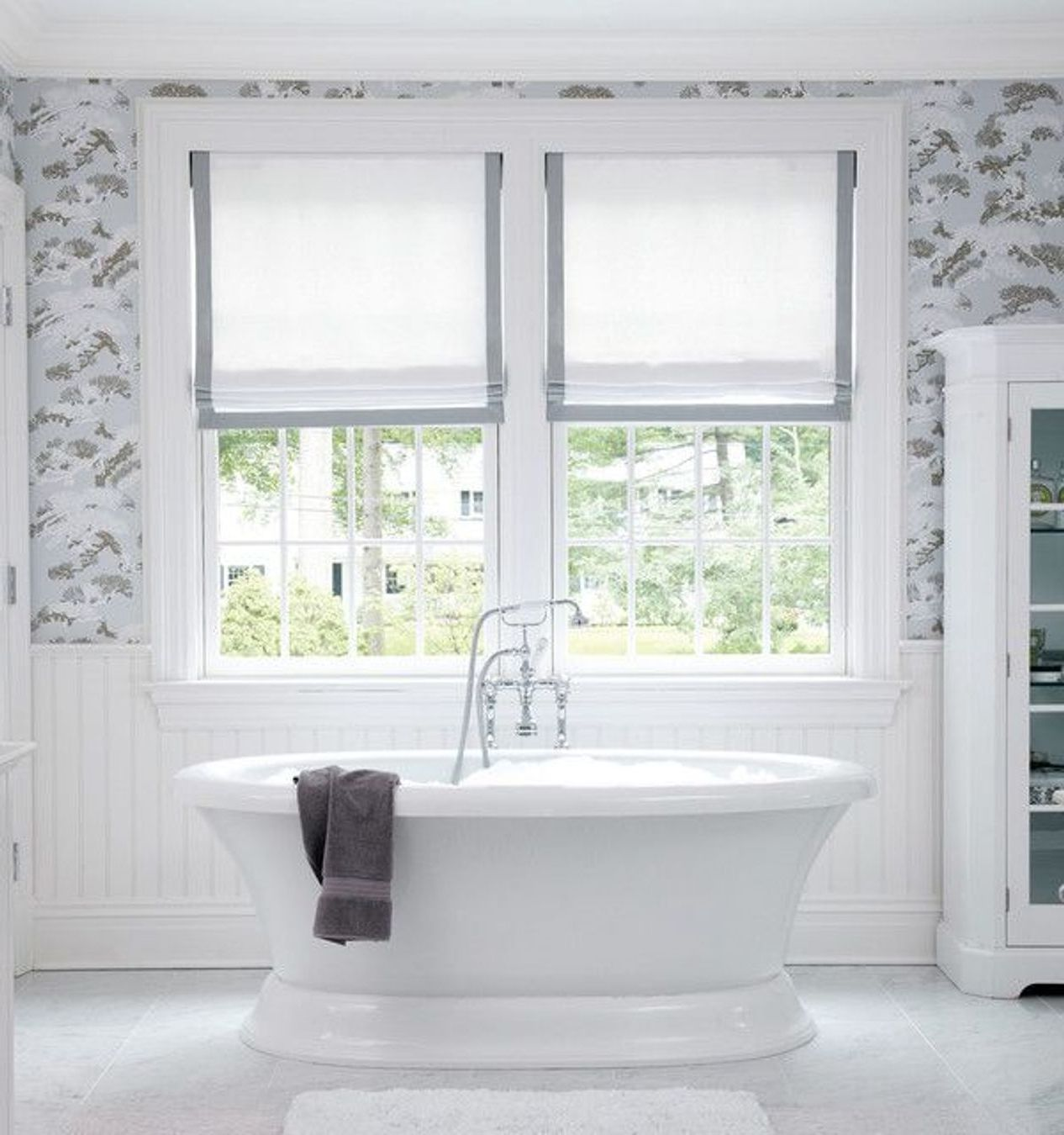 elegant bathroom with white bathtub and white bathroom window curtains