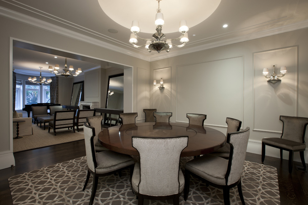Elegant Dining Room Interior with Wood Paneling Painted in Grey and Traditional Lamps