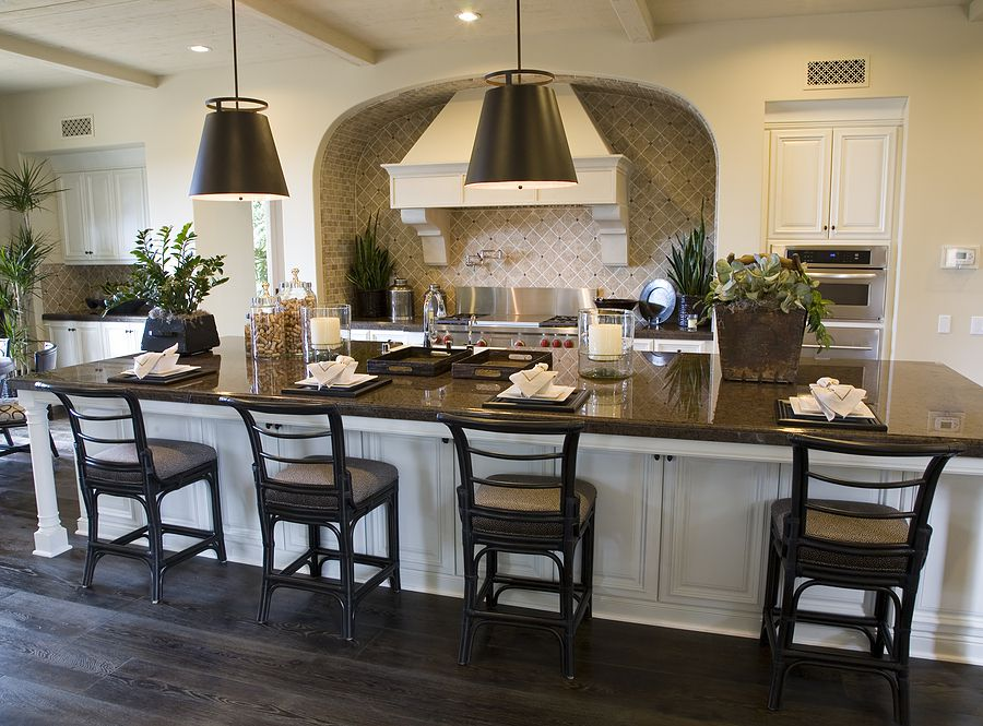 Kitchen remodeling and design, breakfast island, pendant lamps, dark wood cabinetry