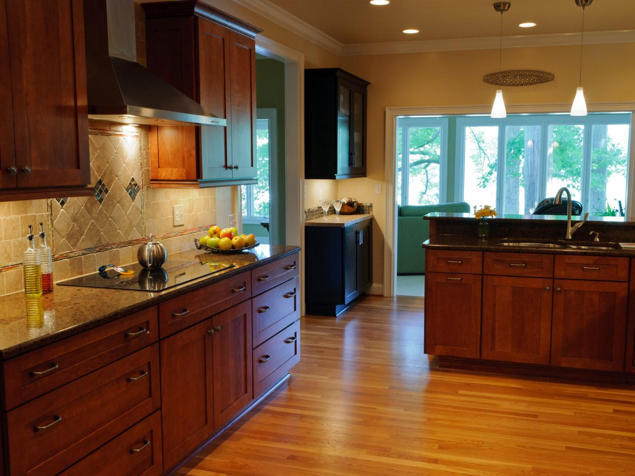Elegant Refinished Kitchen Cabinets with Granite Countertop and Patterned Tile Backsplash