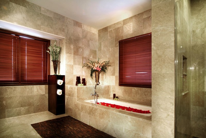 Enjoy your Time inside Cozy Bathroom Design Ideas with White Bathtub Full of Red Rose Petals