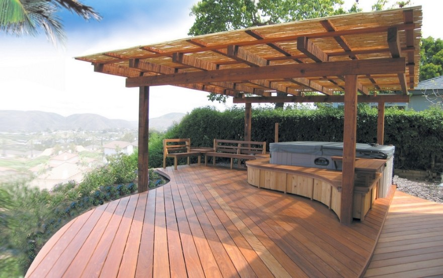 Excellent Wooden Deck in Curvy Shape Design and Parasol Forming Perfect Patio in High Elevation