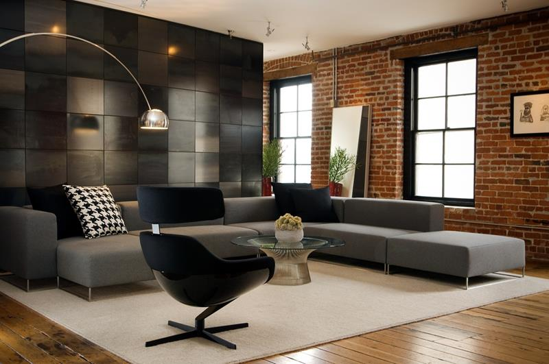 Exposed Brick Wall Completing Awesome Modern Living Room with Grey Sofa Chaise and Glass TopTable