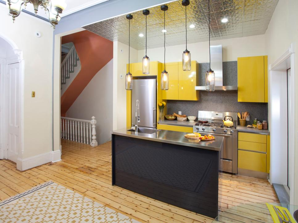 Fashionable Yellow Small Kitchen Ideas Combined With Iron Equipments And Simple Chandelier