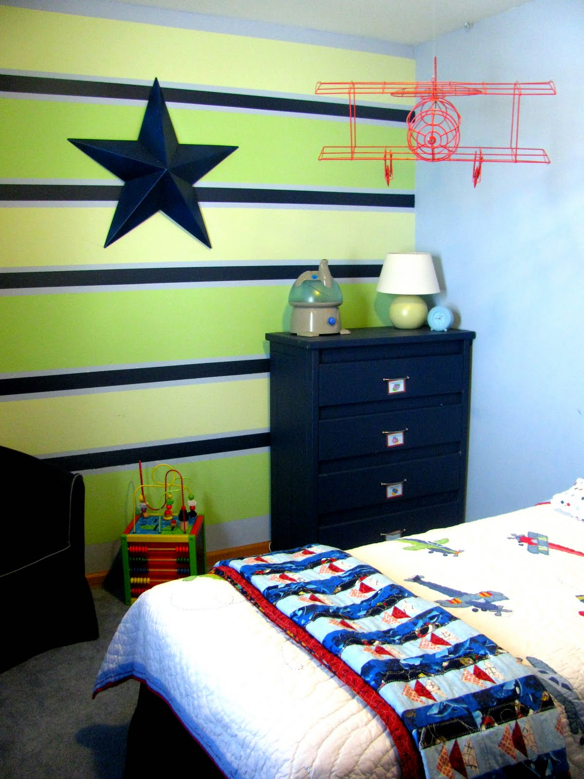 Fill Small Boys Bedroom Ideas with Dark Dresser and Black Leather Kid Sofa on Grey Carpet Flooring
